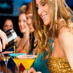 Group of Women Enjoying a Cocktail Making Class