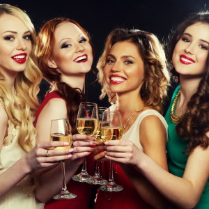 Partying Girls Drinking Sparkling Wine