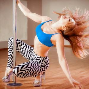 Woman Swinging on Pole