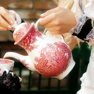 Woman Pouring Afternoon Tea