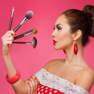 Woman with Four Makeup Brushes