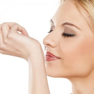 Woman Smelling her Perfume