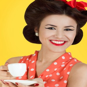 Woman at Vintage Tea Party with Cup and Saucer