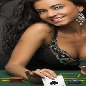 Woman Playing Poker in Casino