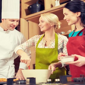 Chef and Two Women in Cookery Class