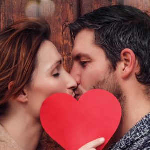 Two Lovers Kissing with Red Heart