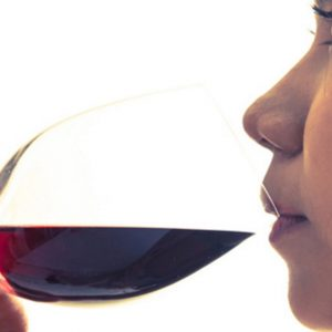 Lady Enjoying a Glass of Red Wine