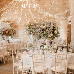 Wedding Dinner Setting with White Linen and Flowers