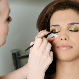 Mobile Makeup Artist Working on Eyelids