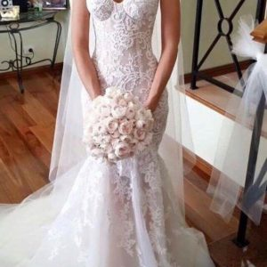 White Wedding Dress with a Bouquet of Flowers