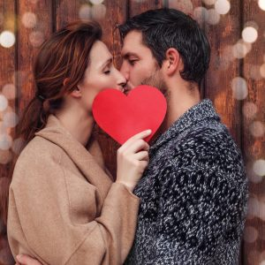 Couple Kissing with a Red Heart